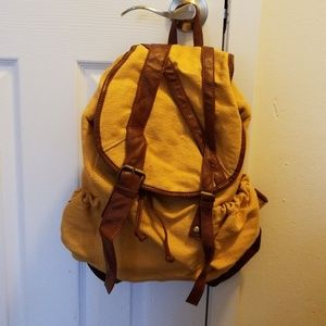 Mustard and brown canvas back pack